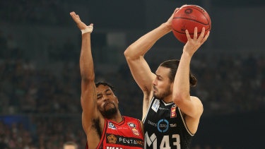 Perth's Bryce Cotton defending against Melbourne United's Chris Goulding.