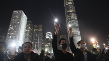 Protesters hold up their smartphone lights during a rally by education workers in Hong Kong, on Friday  January 3.