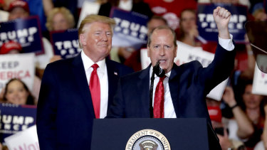 President Donald Trump, left, gives his support to Dan Bishop, right, a Republican running in the special North Carolina ballot.