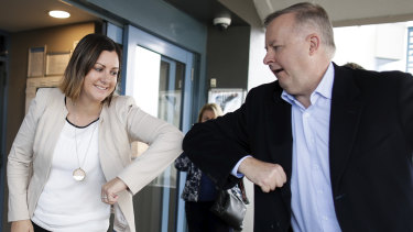 Kristy McBain, Labor candidate for Eden-Monaro, is greeted with an 'elbow tap' by Opposition Leader Anthony Albanese during their visit to Merimbula