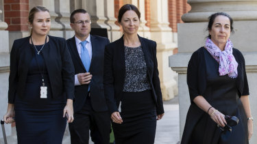 Prosecutor Carmel Barbagallo (right) leaves the Supreme Court of Western Australia on Tuesday. Ms Barbagallo is the lead prosecutor in Bradley Robert Edwards' murder trial.