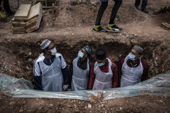 A grave is prepared for a COVID-19 victim in Johannesburg, South Africa, where a hyper-infectious strain of the coronavirus has spread.