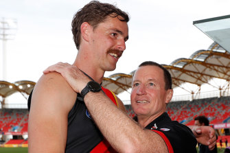 Bomber Joe Daniher and coach John Worsfold after the Bombers' last match of 2020.