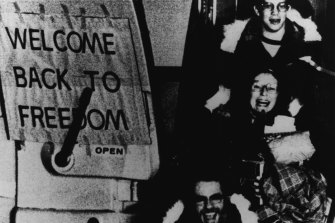 Free At Last -- American hostages released from Iran are all smiles as they arrive at an airport in West Germany following a flight from Algeria. February 26, 1981.