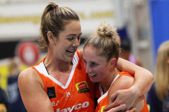 Jenna O'Hea, left, and Flyers teammate Rebecca Cole, right, celebrate a round eight win over the Boomers.