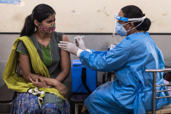 Around 2.1 million people are being vaccinated every day in India, but so far it's not enough to curb infections.