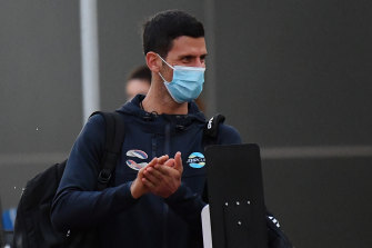 Novak Djokovic arrives to serve hotel quarantine in Adelaide before the Australian Open.