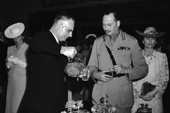 The Duke of Gloucester at the reception after being sworn in as Governor General with Prime Minister John Curtin, 30 January 1945.