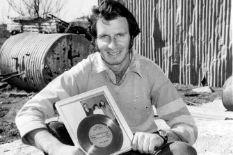 Steven Walls with a gold record of the song 'Little Boy Lost' at his farm near Guyra in 1981.