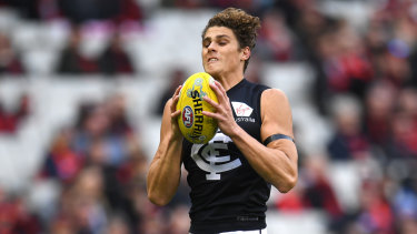 Safe hands: Charlie Curnow in action for Carlton during the round 11 clash against Essendon.