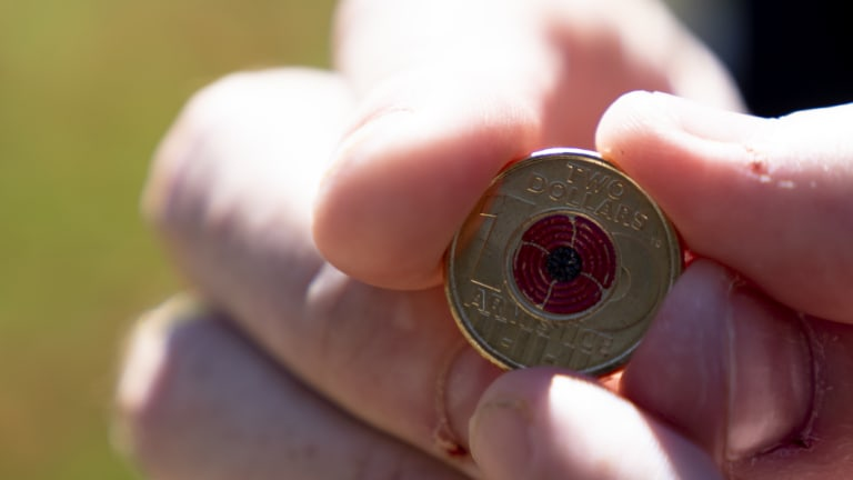 The new $2 coin, featuring a red poppy, produced to mark the centenary of the armistice that ended the First World War.