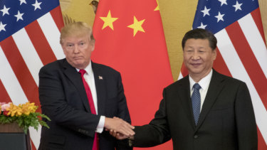 Donald Trump says he is the one holding up a trade pact with China.