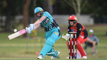 Heave ho: Brisbane top-scorer Sammy-Jo Johnson gets on the front foot against the Renegades.