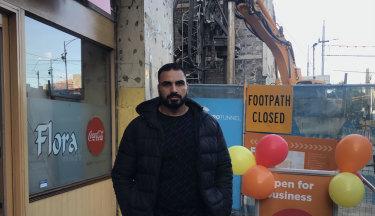 PK outside his parents' Flora Indian Restaurant.