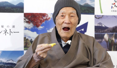 Masazo Nonaka eats cake on April 10, 2018 after the Guinness World Records recognised him as the world's oldest living man at the tender age of 112 years and 259 days.