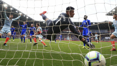 Chelsea's Cesar Azpilicueta scores his side's first goal at Cardiff City Stadium on Sunday.