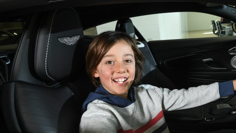 Luca from Little Big Shots sits behind the wheel of an Aston Martin DB11.