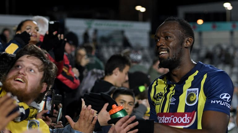 Fan favourite: Reactions have ranged from harsh to kind after Usain Bolt's debut, but the Mariners fans enjoyed the spectacle.