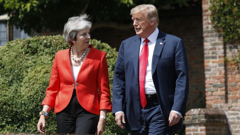 Donald Trump and Theresa May walk out together to begin their joint news conference.