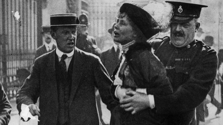 Suffragette leader Emmeline Pankhurst  is arrested outside Buckingham Palace in 1914