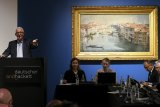 Business has never been better for Australia's art auctioneers. This picture, taken in April, show's Arthur Streeton's The Grand Canal being auctioned off by Deutscher and Hackett in Melbourne.