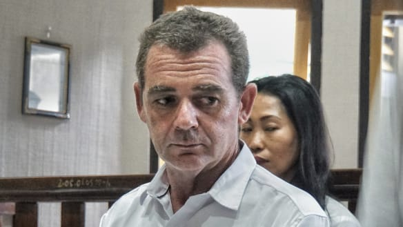 Brendon Luke Johnsson in court for his first trial, his co-defendant Remi Purwanti in the back. Both are facing a maximum death penalty.