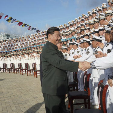 President Xi Jinping attends the commissioning of China's first entirely home-built aircraft carrier in December.
