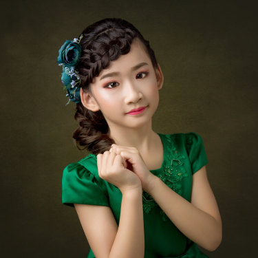 Isabella Lu, 9, practises piano for six and a half hours a day and recently became the youngest person to headline a performance at the Sydney Opera House.