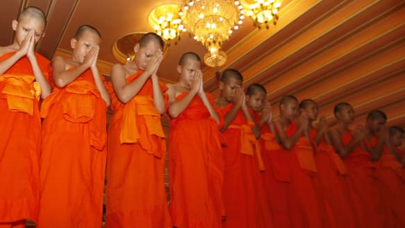 Thailand's cave boys leave Buddhist temple, but stay out of spotlight