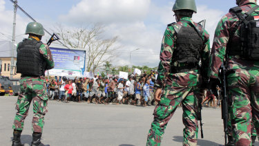Indonesian soldiers stand guard during a protest in Timika, Papua province.