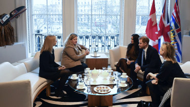 Prince Harry and Meghan talk with the High Commissioner for Canada in the UK ,Janice Charette (second left) and Deputy High Commissioner Sarah Fountain Smith (left) during their visit to Canada House in London.