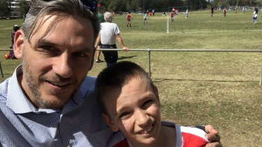 Greens MP Michael Berkman with his son, Noah, at a junior football match.