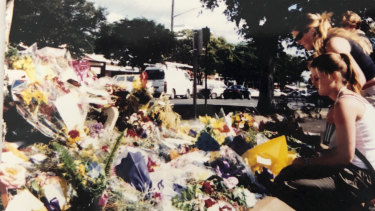 The sisters at a memorial for victims of the fire in Childers, Queensland.