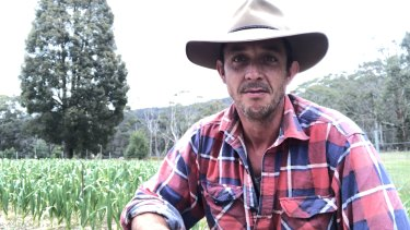 Playwright Angus Cerini on his garlic farm in Victoria's Strathbogie Ranges.