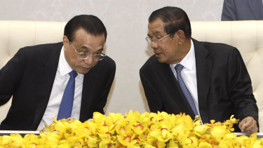 Closer ties: China's Premier Li Keqiang, left, talks with his Cambodian counterpart Hun Sen, during a signing ceremony at Peace Palace in Phnom Penh, on January 11.