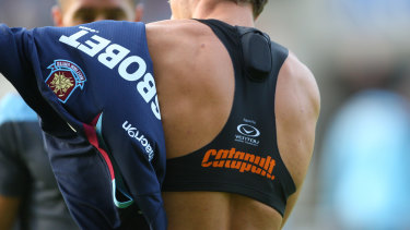 An athlete wears a Catapult heart monitor inside the  vest.