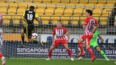 Jump shot: Wellington's Sarpreet Singh fires an effort on goal against Melbourne City.