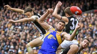 West Coast's Jack Darling battles a several Pies in the air.