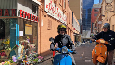 Members of the Vespa Club of Melbourne pay tribute to Pellegrinis Bar co-owner Sisto Malaspina, who was killed in the Bourke Street terror attack.