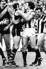 Richmond's Kevin Bartlett and Collingwood's Stan Magro clash in the 1980 grand final.