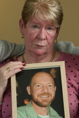 Joy Van Duinen holds a photo of her son Gary, who took his own life after a 13-hour gambling binge.