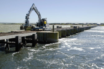 Gates of the Goolwa barrage near the mouth of the Murray River in South Australia. The barrages were first  installed in the late 1930s and 1940s.