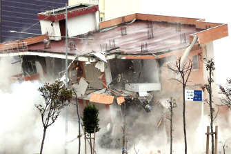 The Albanian army uses a remote-controlled explosion to demolish a building in the western port city of Durres, Albania. The quake killed 51 persons, injured more than 3000 people, and damaged more than 11,000 buildings.
