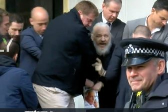 Julian Assange is carried from the Ecuadoran embassy on Thursday.