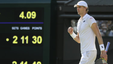 Damned with faint praise: Kevin Anderson celebrates winning his men's quarter-final match against Roger Federer.