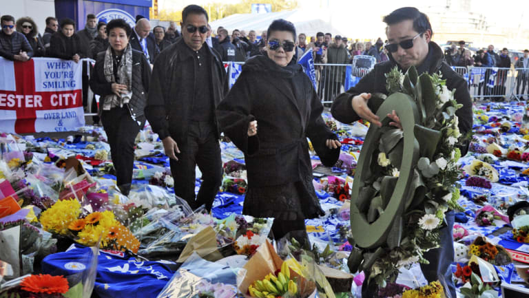 Aiyawatt Srivaddhanaprabha (right) and his mother Aimon (second right) lay a wreath outside Leicester City Football Club.