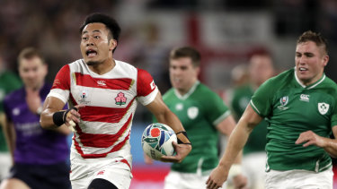 Heading for glory: Japan's Kenki Fukuoka streaks away against Ireland at Shizuoka Stadium Ecopa.