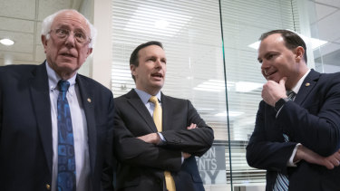 From left, Senators Bernie Sanders, Chris Murphy and Mike Lee after the Yemen vote.
