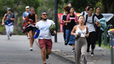Revellers sprint for the best spot at Mrs Macquarie's Chair.