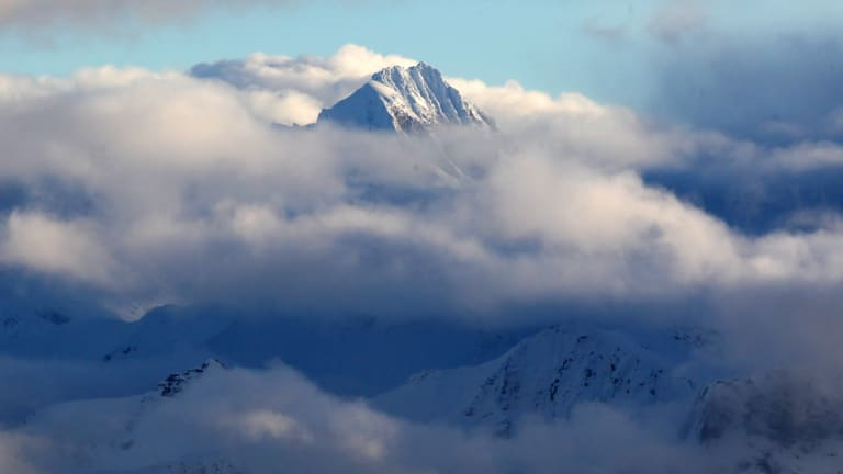 A view of Mount Aspiring's peak through the clouds on New Zealand's South Island.
